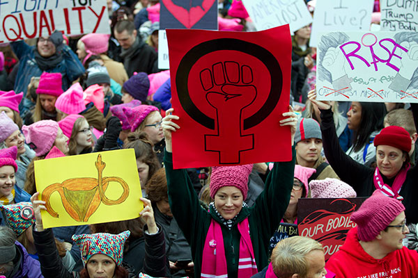 <div class='meta'><div class='origin-logo' data-origin='none'></div><span class='caption-text' data-credit='Jose Luis Magana/AP Photo'>Women with bright pink hats and signs gather early and are set to make their voices heard on the first full day of Donald Trump's presidency, Saturday, Jan. 21, 2017 in Washington.</span></div>