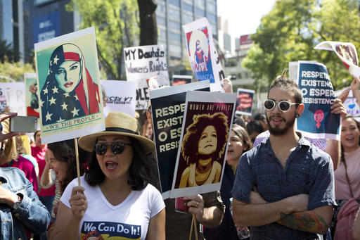 <div class='meta'><div class='origin-logo' data-origin='AP'></div><span class='caption-text' data-credit='AP'>People hold signs during a Women's March protest in front of the U.S. embassy in Mexico City, Saturday.</span></div>
