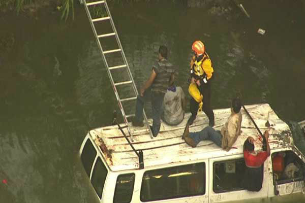 """<div class=""""meta image-caption""""><div class=""""origin-logo origin-image """"><span></span></div><span class=""""caption-text"""">Several passengers were rescued after their van crashed into the White Oak Bayou (KTRK Photo)</span></div>"""