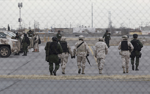 "<div class=""meta image-caption""><div class=""origin-logo origin-image ap""><span>AP</span></div><span class=""caption-text"">Soldiers walk at the airport after the extradition of drug lord Joaquin ""El Chapo"" Guzman in Ciudad Juarez, Mexico, Thursday, Jan. 19, 2017 (AP Photo/Christian Torres)</span></div>"