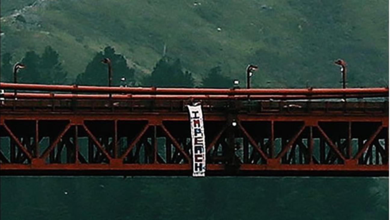 A banner with the word impeach is seen hanging from the Golden Gate Bridge in San Francisco, Calif. on Saturday, January 21, 2017.