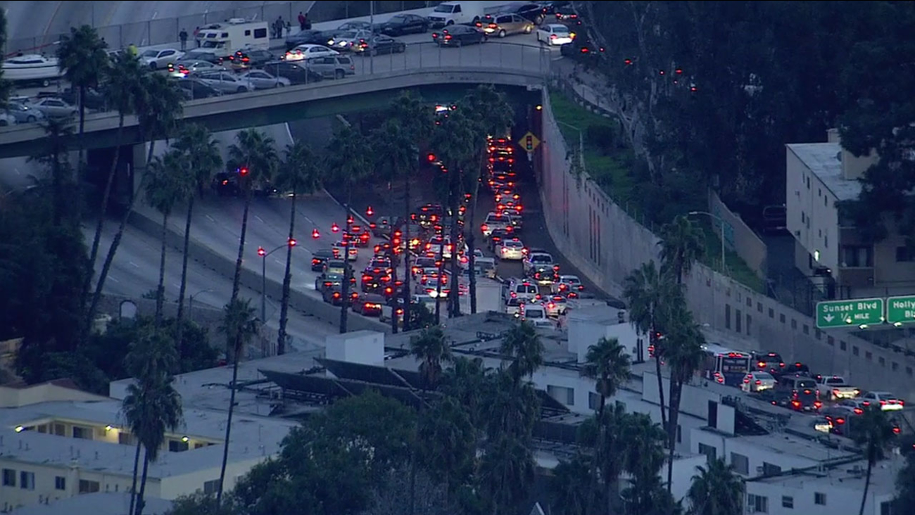 Authorities direct traffic on the southbound side of the 101 Freeway after a person threatened to jump off an overpass in Hollywood on Tuesday, Jan. 24, 2017.