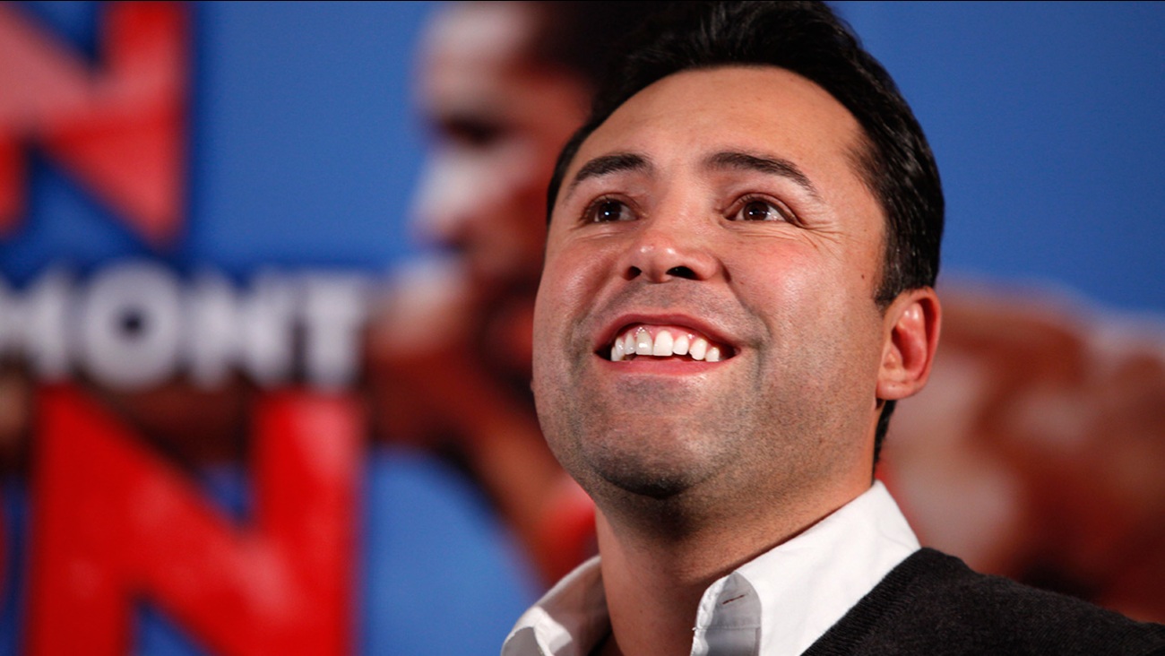 In this Dec. 9, 2011, file photo, boxing promoter Oscar De La Hoya watches during the the weigh-in for a fight between Amir Kahn and Lamont Peterson in Washington.