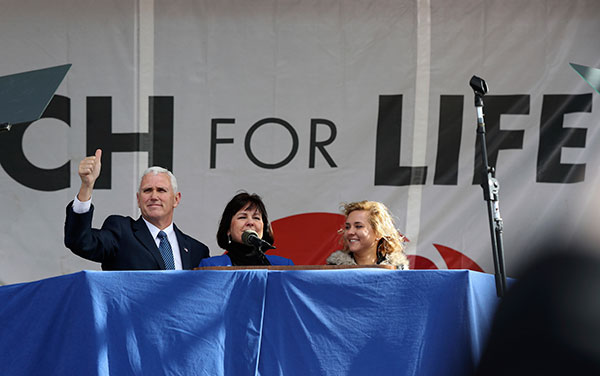 """<div class=""""meta image-caption""""><div class=""""origin-logo origin-image none""""><span>none</span></div><span class=""""caption-text"""">Vice President Mike Pence, with his wife Karen Pence, center, waves while speaking at the March for Life on the National Mall in Washington, Friday, Jan. 27, 2017. (Manuel Balce Ceneta/AP Photo)</span></div>"""
