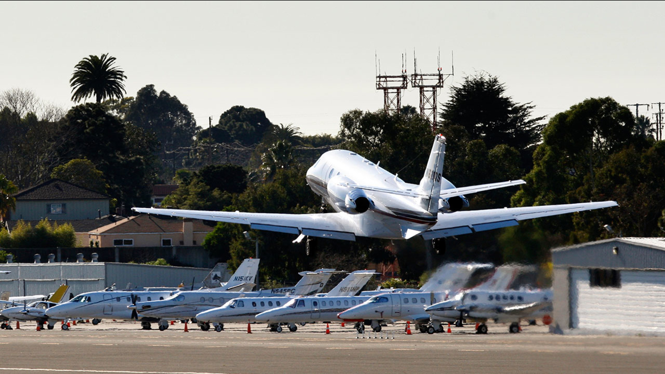 FILE - In this Jan. 21, 2011, file photo, a private jet takes off from the Santa Monica airport in Santa Monica, Calif.