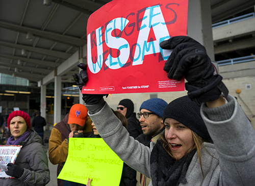 <div class='meta'><div class='origin-logo' data-origin='AP'></div><span class='caption-text' data-credit='AP Photo/Craig Ruttle'>Protesters assemble at John F. Kennedy International Airport in New York, Saturday, Jan. 28, 2017 after two Iraqi refugees were detained while trying to enter the country.</span></div>