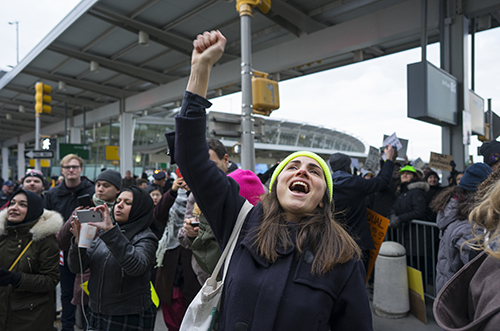 <div class='meta'><div class='origin-logo' data-origin='AP'></div><span class='caption-text' data-credit='AP Photo/Craig Ruttle'>A protester raises her fist and shouts as she joins others assembled at John F. Kennedy International Airport in New York, Saturday, Jan. 28, 2017.</span></div>