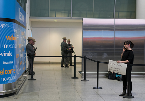 <div class='meta'><div class='origin-logo' data-origin='AP'></div><span class='caption-text' data-credit='AP Photo/Craig Ruttle'>Person holds a sign near an passenger exit point inside Terminal 4 at John F. Kennedy International Airport in New York, Saturday, Jan. 28, 2017.</span></div>