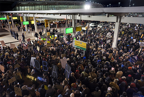 <div class='meta'><div class='origin-logo' data-origin='AP'></div><span class='caption-text' data-credit='AP Photo/Craig Ruttle'>Protesters assemble at John F. Kennedy International Airport in New York Jan. 28, 2017 after earlier in the day two Iraqi refugees were detained while trying to enter the country.</span></div>