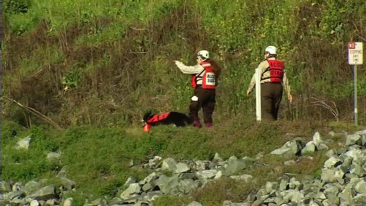 Search crews are seen along Niles Canyon in Fremont on Saturday January 28, 2017.