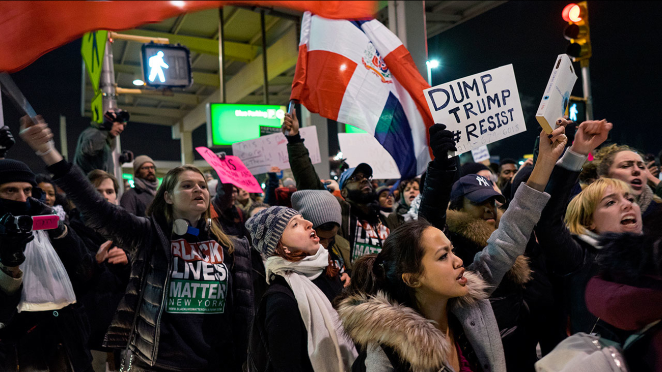 Protesters block an intersection at New York's JFK airport after President Donald Trump signed an order temporarily suspending immigration from countries with terrorism concerns.