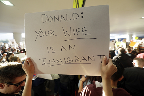 <div class='meta'><div class='origin-logo' data-origin='AP'></div><span class='caption-text' data-credit='AP Photo/Marcio Jose Sanchez'>A protester holds a sign at San Francisco International Airport during a demonstration to denounce President Donald Trump's executive order.</span></div>
