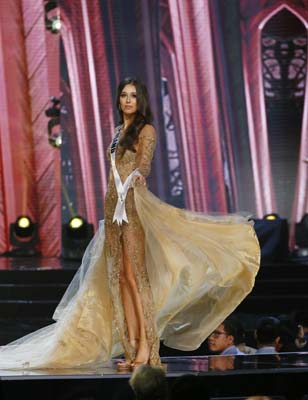 """<div class=""""meta image-caption""""><div class=""""origin-logo origin-image ap""""><span>AP</span></div><span class=""""caption-text"""">Miss Universe contestant Izabella Krzan of Poland presents her evening gown during the preliminary competition of the Miss Universe beauty pageant. (AP Photo/Bullit Marquez) (AP)</span></div>"""