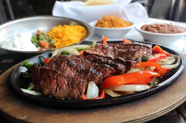<div class='meta'><div class='origin-logo' data-origin='KTRK'></div><span class='caption-text' data-credit=''>Añejo is offering four pounds of fajitas (chicken, beef or mixed) with rice, beans, and tortillas for $145.</span></div>