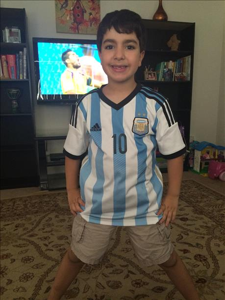 "<div class=""meta image-caption""><div class=""origin-logo origin-image ""><span></span></div><span class=""caption-text"">Aylan is a huge fan of Argentina! Keep sending in your World Cup fan photos! (photo submitted via uReport)</span></div>"
