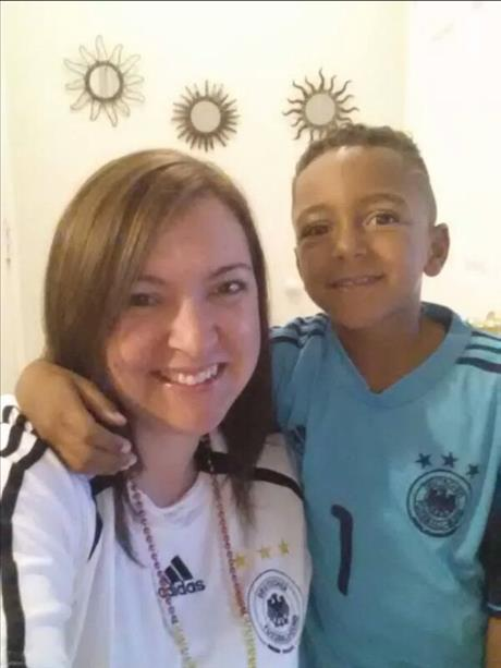 "<div class=""meta image-caption""><div class=""origin-logo origin-image ""><span></span></div><span class=""caption-text"">Mother and son root for Germany! Keep sending in your World Cup fan photos! (photo submitted by Ela P. via uReport)</span></div>"