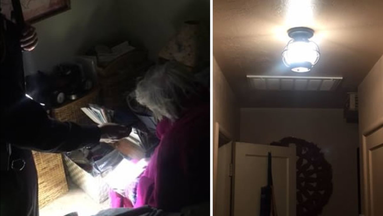 A Concord, Calif. police officer helps an elderly woman pay her power bill.
