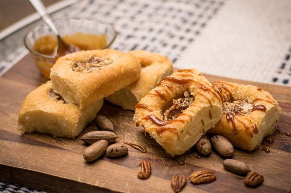 "<div class=""meta image-caption""><div class=""origin-logo origin-image ktrk""><span>KTRK</span></div><span class=""caption-text"">For a sweeter taste of Texas, take a bite of  the ""Drunken Texas Pecan"" kolache featuring Bourbon Cajeta from local Blue Heron Farm, sweet cream cheese and lightly salted Texas pec</span></div>"