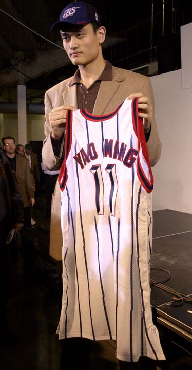 "<div class=""meta image-caption""><div class=""origin-logo origin-image ktrk""><span>KTRK</span></div><span class=""caption-text"">FILE - In this Oct. 20, 2002 file photo, Houston Rockets first round draft pick Yao Ming holds his new game jersey following a news conference. (AP Photo/Brett Coomer, File) (AP)</span></div>"