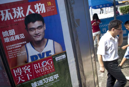 "<div class=""meta image-caption""><div class=""origin-logo origin-image ktrk""><span>KTRK</span></div><span class=""caption-text"">Pedestrians walks past a magazine poster featuring NBA basketball star Yao Ming at a news stand in Beijing, China, Wednesday, July 20, 2011. (AP Photo/Andy Wong) (AP)</span></div>"