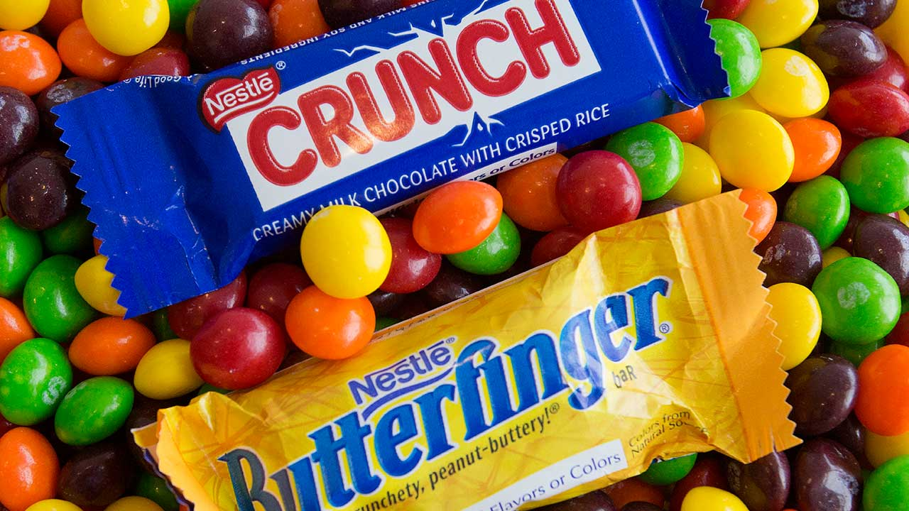 Nestle Crunch and Butterfinger candy bars are arranged for a photo with Skittles, Wednesday, May 25, 2016, in New York.