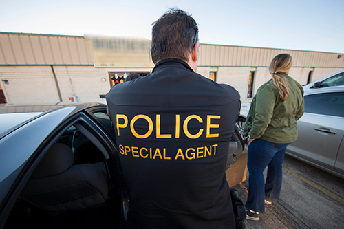 "<div class=""meta image-caption""><div class=""origin-logo origin-image none""><span>none</span></div><span class=""caption-text"">ICE's HSI special agents arrive on scene at the target location suspected of peddling counterfeit merchandise. (Immigration & Customs Enforcement/Twitter)</span></div>"