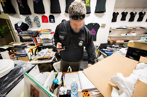 "<div class=""meta image-caption""><div class=""origin-logo origin-image none""><span>none</span></div><span class=""caption-text"">HSI special agents examine purchase records and continue investigating the scene. (Immigration & Customs Enforcement/Twitter)</span></div>"