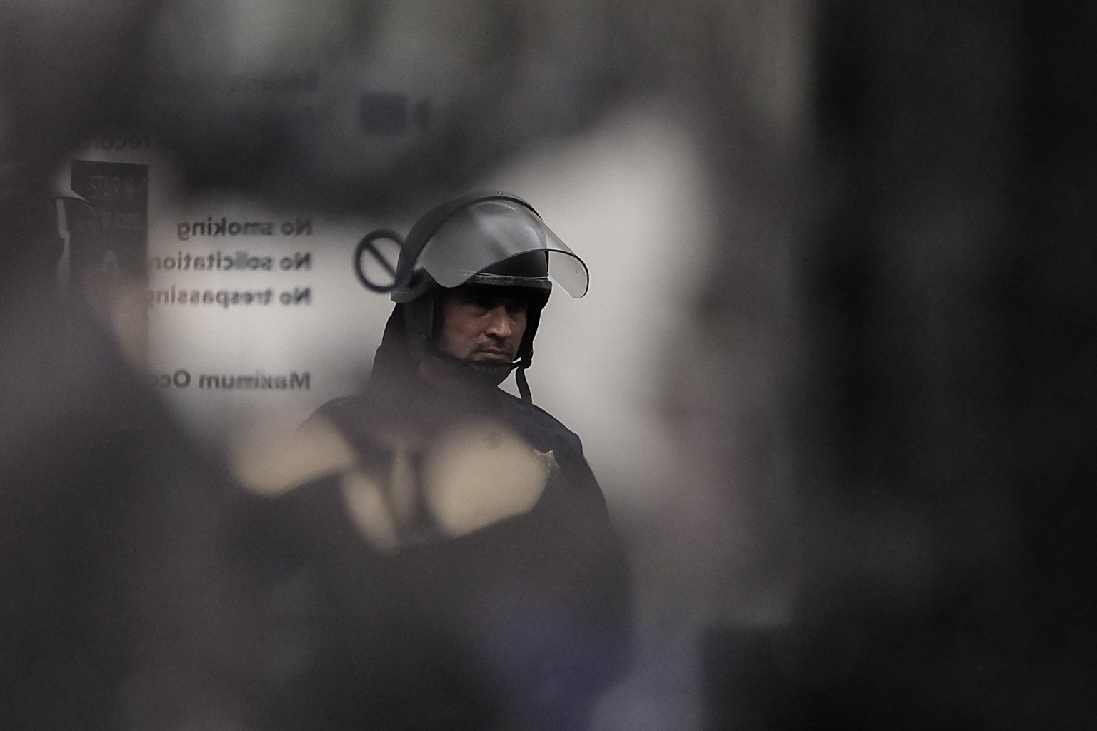 <div class='meta'><div class='origin-logo' data-origin='none'></div><span class='caption-text' data-credit='KGO-TV'>A police officer in riot gear stands in the Martin Luther King Student Union at U.C. Berkeley during a violent protest on Feb. 2. 2017.</span></div>