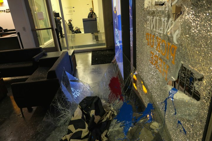 <div class='meta'><div class='origin-logo' data-origin='none'></div><span class='caption-text' data-credit='Wayne Freedman'>Broken glass litters the ground of the Martin Luther King Student Union at U.C. Berkeley on Feb. 2, 2017.</span></div>