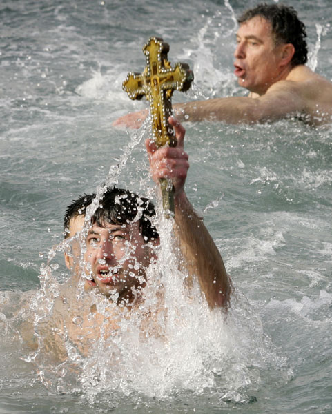"<div class=""meta image-caption""><div class=""origin-logo origin-image none""><span>none</span></div><span class=""caption-text"">Greek Orthodox men brave the cold weather to dive into Istanbul's Golden Horn and retrieve a wooden cross in a ceremony commemorating Epiphany or the baptism of Jesus Christ. ((AP Photo/Ibrahim Usta))</span></div>"