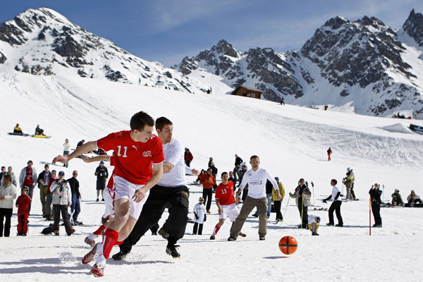 <div class='meta'><div class='origin-logo' data-origin='none'></div><span class='caption-text' data-credit='(AP Photo/Keystone, Jean-Christophe Bott)'>Players fight for the ball during a soccer match in the snow at a height of 2,250 meters over sea level, in the resort of Verbier, Switzerland, Saturday, April 26, 2008.</span></div>