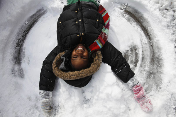<div class='meta'><div class='origin-logo' data-origin='AP'></div><span class='caption-text' data-credit='(AP Photo/Jacquelyn Martin)'>Jamilya Rich, 10, of Washington, makes a snow angel by the sidewalk in Washington, on Monday, March 2, 2009.</span></div>