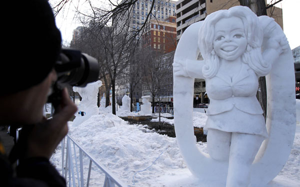 "<div class=""meta image-caption""><div class=""origin-logo origin-image none""><span>none</span></div><span class=""caption-text"">A man takes a photo in front of ""SnOpra"" snow sculpture at Grant Park in Chicago. ((AP Photo/Nam Y. Huh))</span></div>"