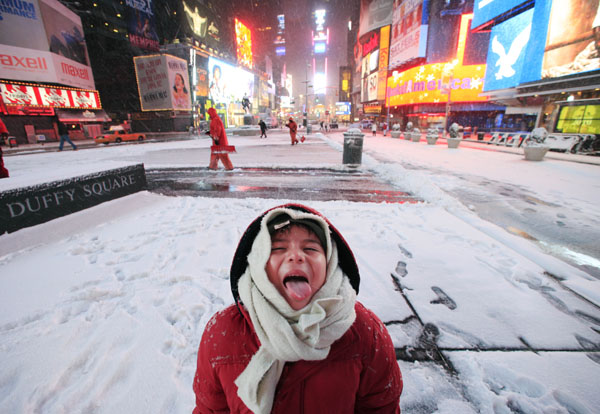 <div class='meta'><div class='origin-logo' data-origin='AP'></div><span class='caption-text' data-credit='(AP Photo/Mark Lennihan)'>Diego Penaloza, 6, of Mexico City, catches snowflakes on his tongue during a visit to Times Square, Friday, Jan. 21, 2011 in New York.</span></div>