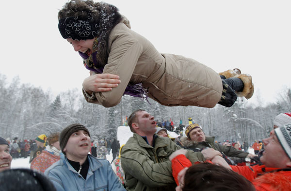 <div class='meta'><div class='origin-logo' data-origin='none'></div><span class='caption-text' data-credit='(AP Photo/Ivan Sekretarev)'>A woman is thrown in the air as she celebrates Maslenitsa, or Pancake Week, a traditional Russian holiday marking the end of winter that dates back to the pagan times.</span></div>