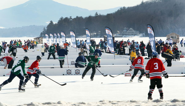 <div class='meta'><div class='origin-logo' data-origin='none'></div><span class='caption-text' data-credit='(AP Photo/Jim Cole)'>Hundreds of hockey players participate in the Pond Hockey ice hockey tournament in Lake Winnipesaukee's Meredith Bay Friday Jan. 31, 2014 in Meredith, N.H.</span></div>