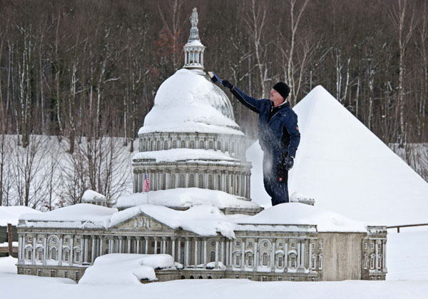 <div class='meta'><div class='origin-logo' data-origin='none'></div><span class='caption-text' data-credit='(AP Photo/Jens Meyer)'>Gunter Hersch cleans a model of the Capitol of Washington model after heavy snowfall in the landscape park Miniwelt (Miniworld) in Lichtenstein, Germany, Friday, Dec. 7, 2012.</span></div>