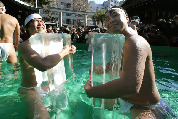<div class='meta'><div class='origin-logo' data-origin='none'></div><span class='caption-text' data-credit='(AP Photo/Shizuo Kambayashi)'>Japanese physical fitness enthusiasts hold blocks of ice while standing in cold water during a winter ritual to keep themselves fit and to display their perseverance in Tokyo.</span></div>