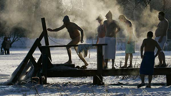 "<div class=""meta image-caption""><div class=""origin-logo origin-image none""><span>none</span></div><span class=""caption-text"">Russian men enjoy swimming in an ice hole on a lake after relaxing in sauna just outside St. Petersburg, Russia, Sunday, Jan. 4, 2009. ((AP Photo/Dmitry Lovetsky))</span></div>"