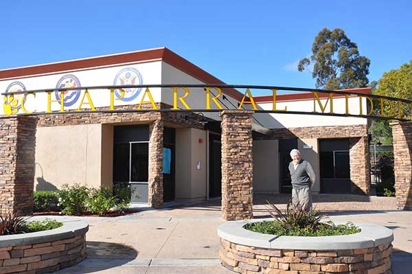 <div class='meta'><div class='origin-logo' data-origin='none'></div><span class='caption-text' data-credit='Walnut Valley Unified School District'>Volunteer artist Cornelis Greive stands outside Chaparral Middle School in Diamond Bar.</span></div>