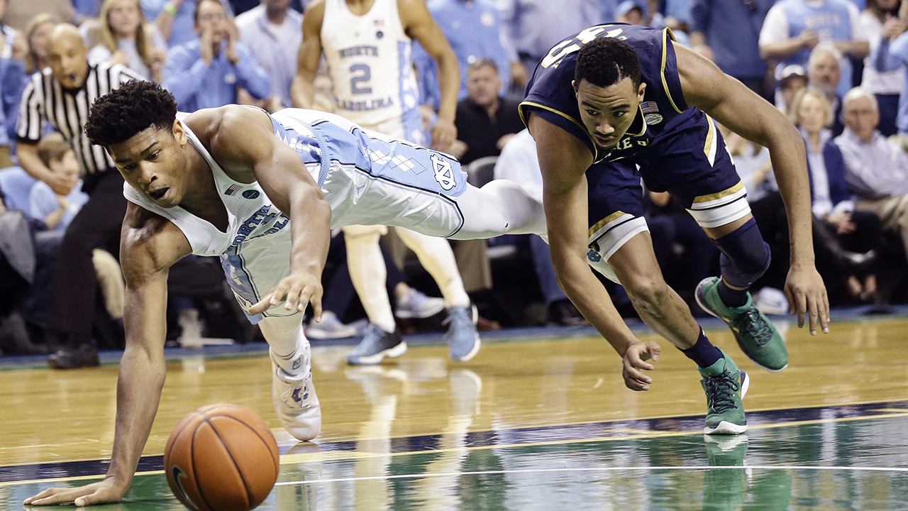 North Carolina's Isaiah Hicks, left, and Notre Dame's Bonzie Colson chase the ball during the second half of an NCAA college basketball game in Greensboro, N.C., Sunday, Feb. 5, 2017.