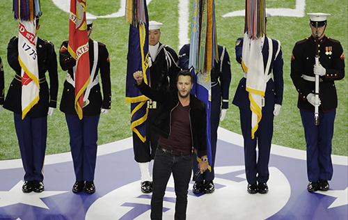 """<div class=""""meta image-caption""""><div class=""""origin-logo origin-image ap""""><span>AP</span></div><span class=""""caption-text"""">Country music artist Luke Bryan sings the national anthem before the NFL Super Bowl 51 football game between the Atlanta Falcons and the New England Patriots, Sunday, Feb. 5, 2017. (AP Photo/Charlie Riedel)</span></div>"""