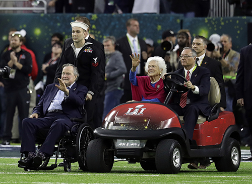 """<div class=""""meta image-caption""""><div class=""""origin-logo origin-image ap""""><span>AP</span></div><span class=""""caption-text"""">Former President George H.W. Bush and wife, Barbara, wave as they arrive on the field for a coin toss before the NFL Super Bowl 51 football game. (AP Photo/Eric Gay)</span></div>"""