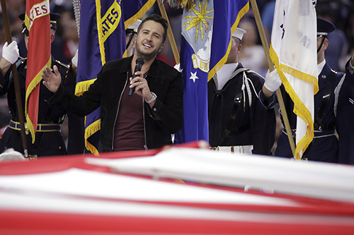 """<div class=""""meta image-caption""""><div class=""""origin-logo origin-image ap""""><span>AP</span></div><span class=""""caption-text"""">Country music singer Luke Bryan sings the National Anthem, before the NFL Super Bowl 51 football game between the New England Patriots and the Atlanta Falcons. (AP Photo/Patrick Semansky)</span></div>"""