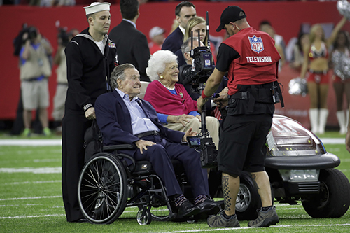 """<div class=""""meta image-caption""""><div class=""""origin-logo origin-image ap""""><span>AP</span></div><span class=""""caption-text"""">Former President George H.W. Bush and wife, Barbara enter the field, before the NFL Super Bowl 51 football game between the New England Patriots and the Atlanta Falcons. (AP Photo/Patrick Semansky)</span></div>"""