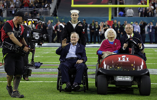 """<div class=""""meta image-caption""""><div class=""""origin-logo origin-image ap""""><span>AP</span></div><span class=""""caption-text"""">Former President George H.W. Bush and wife, Barbara wave as they arrive on the field for a coin toss before the NFL Super Bowl 51 football game. (AP Photo/David J. Phillip)</span></div>"""