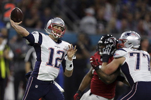 <div class='meta'><div class='origin-logo' data-origin='AP'></div><span class='caption-text' data-credit='AP'>New England Patriots' Tom Brady looks to pass, during the first half the NFL Super Bowl 51 football game against the Atlanta Falcons, Sunday, Feb. 5, 2017, in Houston.</span></div>