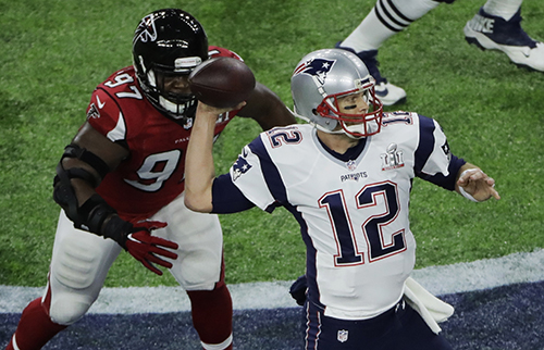 <div class='meta'><div class='origin-logo' data-origin='AP'></div><span class='caption-text' data-credit='AP'>New England Patriots' Tom Brady passes under pressure from Atlanta Falcons' Grady Jarrett during the first half of NFL Super Bowl 51.</span></div>