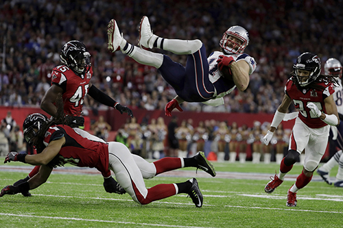 <div class='meta'><div class='origin-logo' data-origin='AP'></div><span class='caption-text' data-credit='AP'>New England Patriots' Julian Edelman is up ended by Atlanta Falcons' Philip Wheeler, during the first half of the NFL Super Bowl 51 football game Sunday, Feb. 5, 2017, in Houston.</span></div>