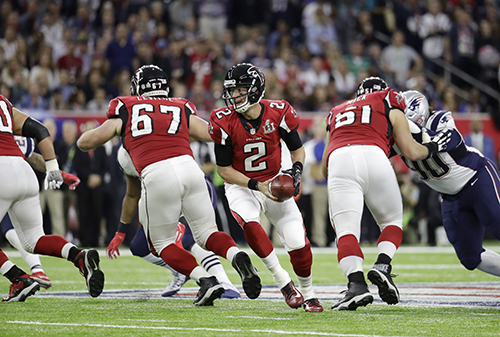 <div class='meta'><div class='origin-logo' data-origin='AP'></div><span class='caption-text' data-credit='AP'>Atlanta Falcons' Matt Ryan, center, plays against the New England Patriots during the first half of the NFL Super Bowl 51 football game Sunday, Feb. 5, 2017, in Houston.</span></div>
